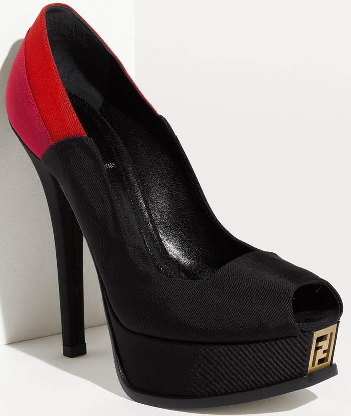 Bright colors saturate the back of a lofty satin pump. A logo ornament is embedded in the platform of the open-toe style.