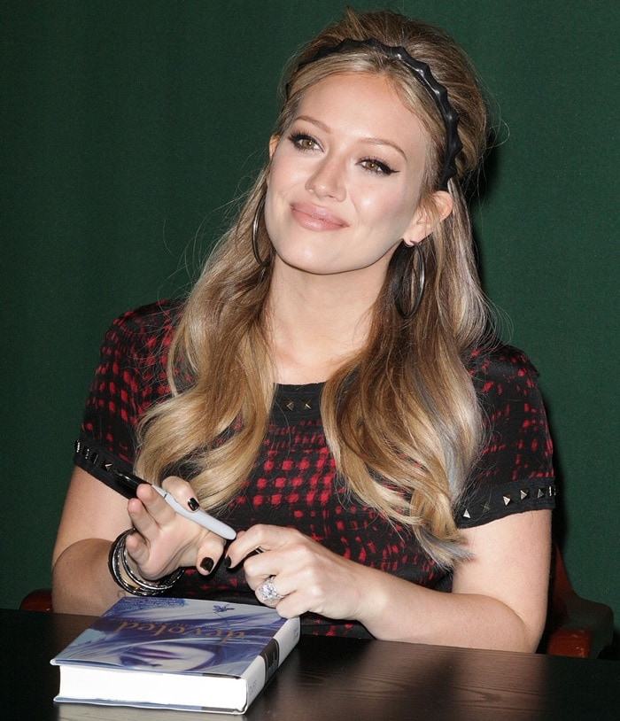 "Hilary Duff poses for pictures and signs copies of her new book ""Devoted"""