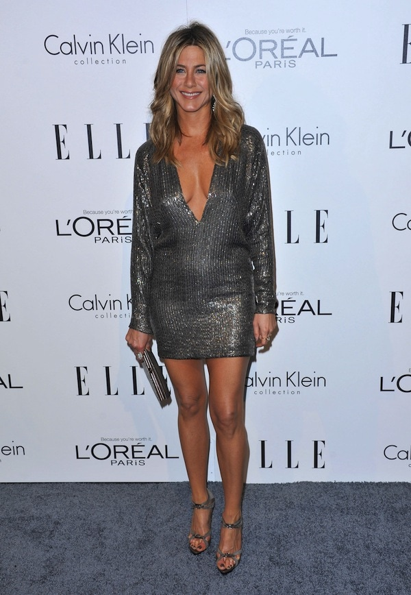 Jennifer Aniston shows off her cleavage in a sparkling dress from KaufmanFranco