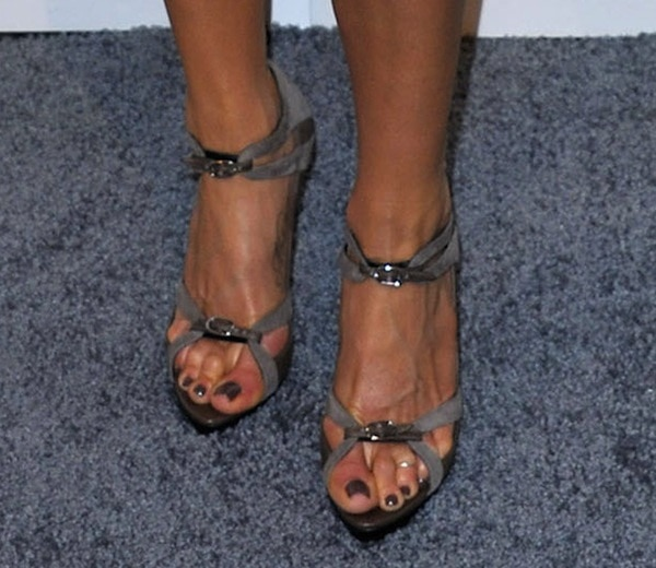 Jennifer Aniston matches her steely pedicure to her Balenciaga pumps