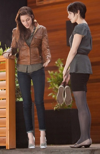 Bella Swan trying on her high-heeled wedding shoes
