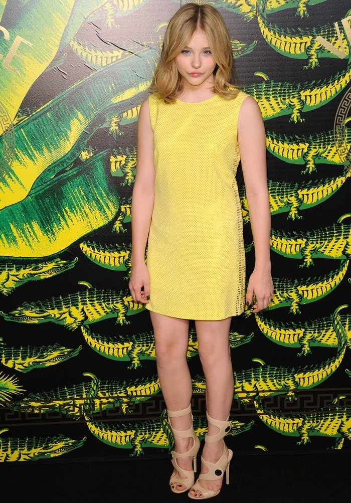 Chloe Moretz attends the Versace for H&M fashion event held at the H&M boutique on the Hudson in New York City on November 8, 2011