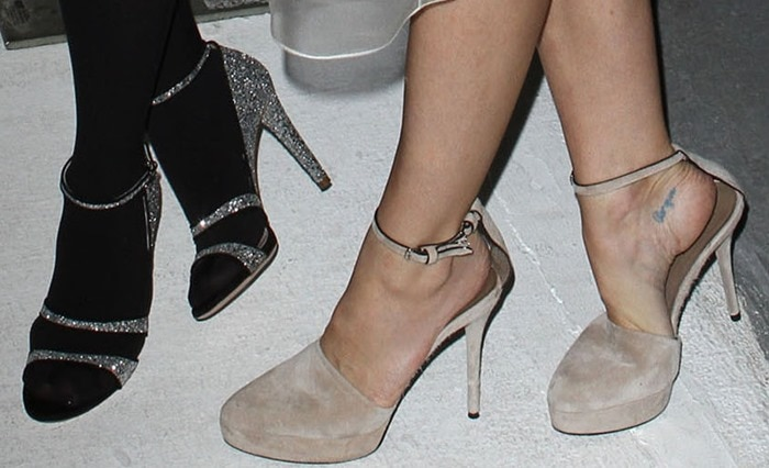 Jaime King and Chloe Moretz showing off their shoes at the 2011 Hollywood Style Awards