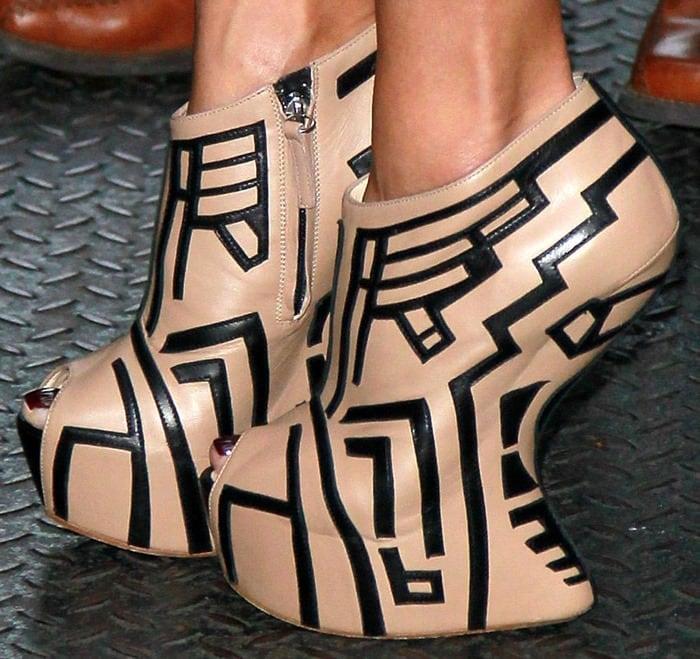 Nicole Scherzinger's geometric beige and black heel-less booties