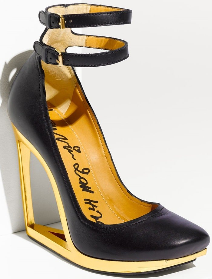 A gleaming, cutout heel lifts a statement-making leather pump topped with two adjustable ankle straps