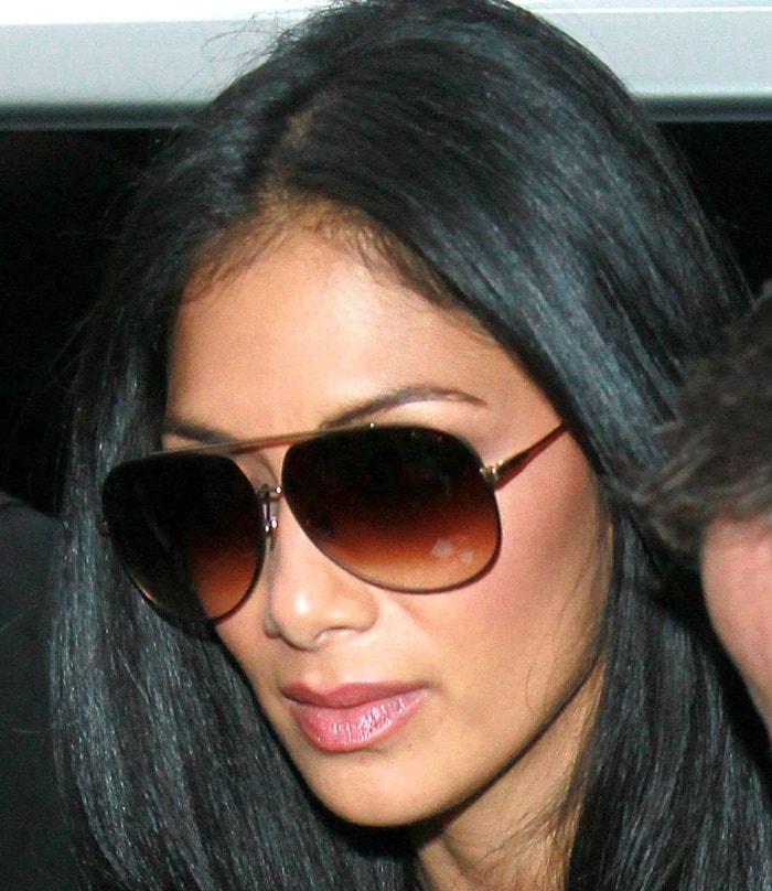 Nicole Scherzinger poses for pictures and signs autographs for fans outside the BBC Radio 1 Studios in London on October 28, 2011
