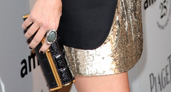 Sandra Bullock accessorizes with a cocktail ring and a Jimmy Choo clutch