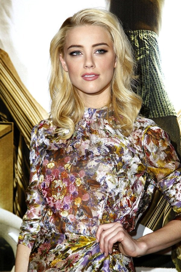 Amber Heard displaying her class and sophistication in a Reem Acra silk top and skirt