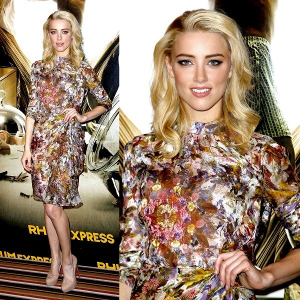 Amber Heard showing off her sexy legs at a recent photo call for'The Rum Diary'
