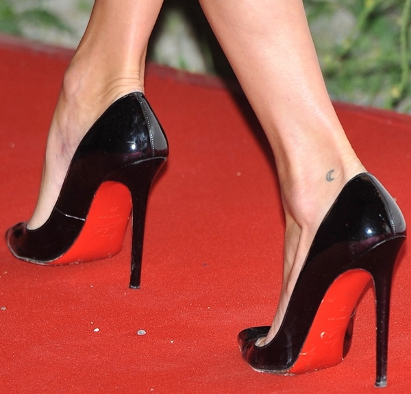 Kate Moss wears black patent Christian Louboutin pumps