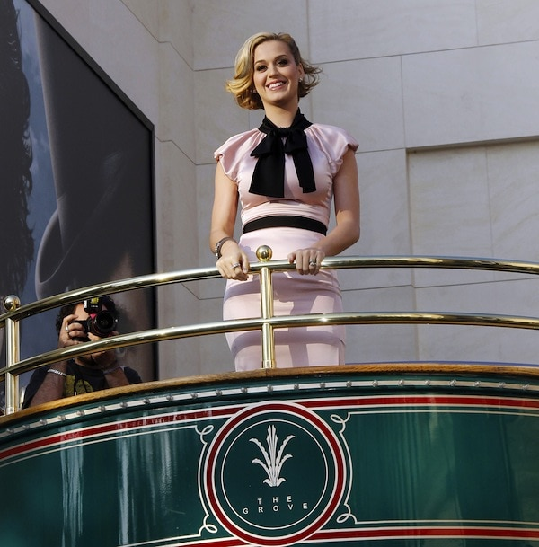 """Katy Perry looking glamorous as she arrives on a trolley car for the launch of her new fragrance """"Meow!"""""""