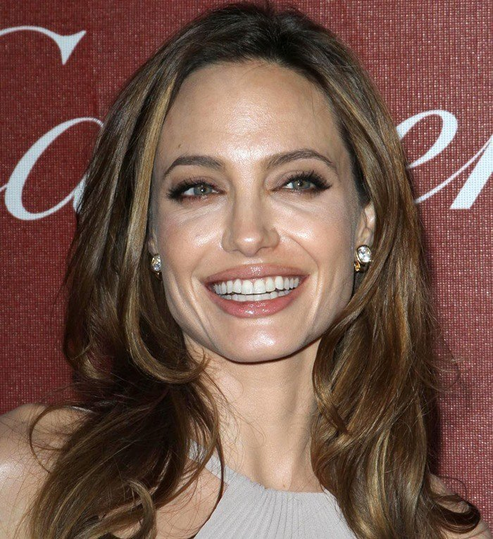 Angelina Jolie shows off her earrings with softly tousled hair