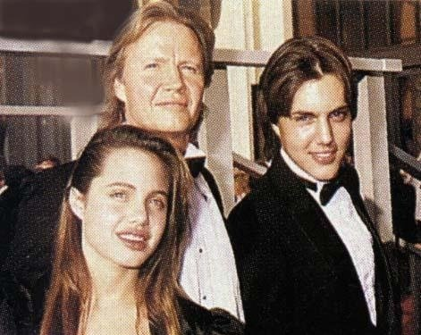 Pictured with her brother James Haven and her father Jon Voight, Angelina Jolie was bullied in high school and reportedly suffered from the common eating disorder anorexia