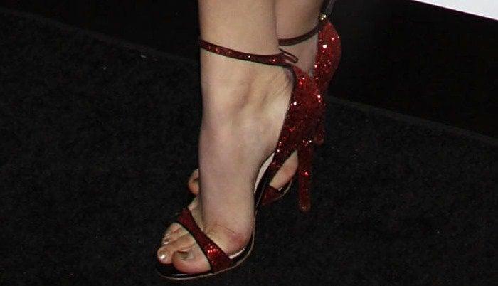 Chloe Moretz shows off her pretty feet in red heels