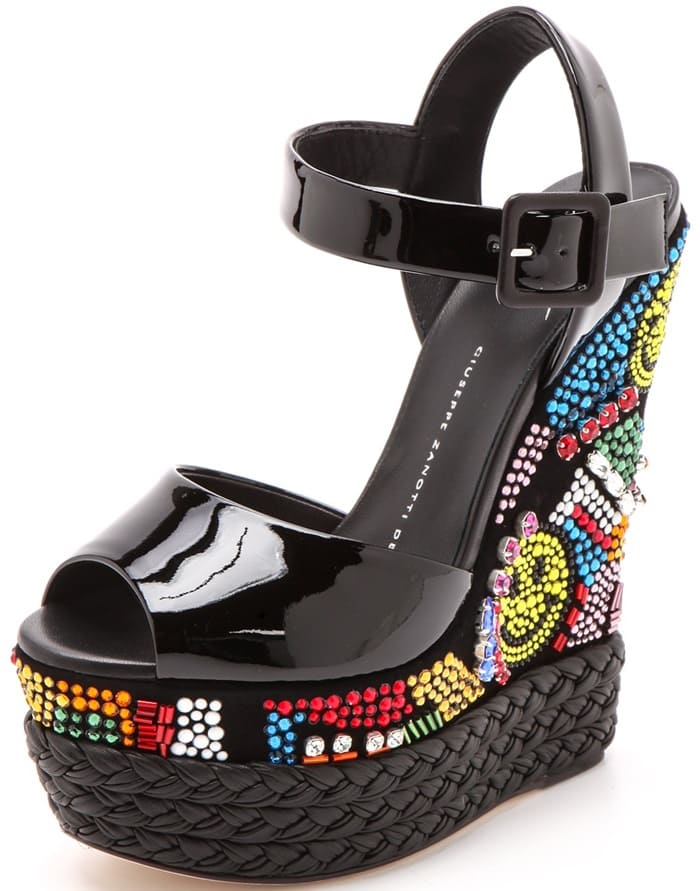 Colorful Swarovski crystals create a shimmering, '90s-inspired design across the steep platform and wedge heel of these patent leather Giuseppe Zanotti sandals.
