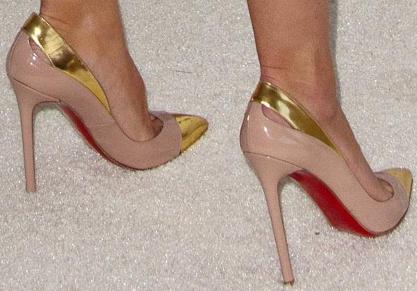 Heidi Klum's hot feet inpointy toe pumps from Christian Louboutin