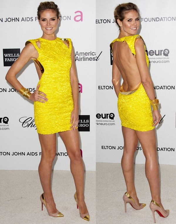 Heidi Klum's sexy legs inan Atelier Versace yellow structure dress
