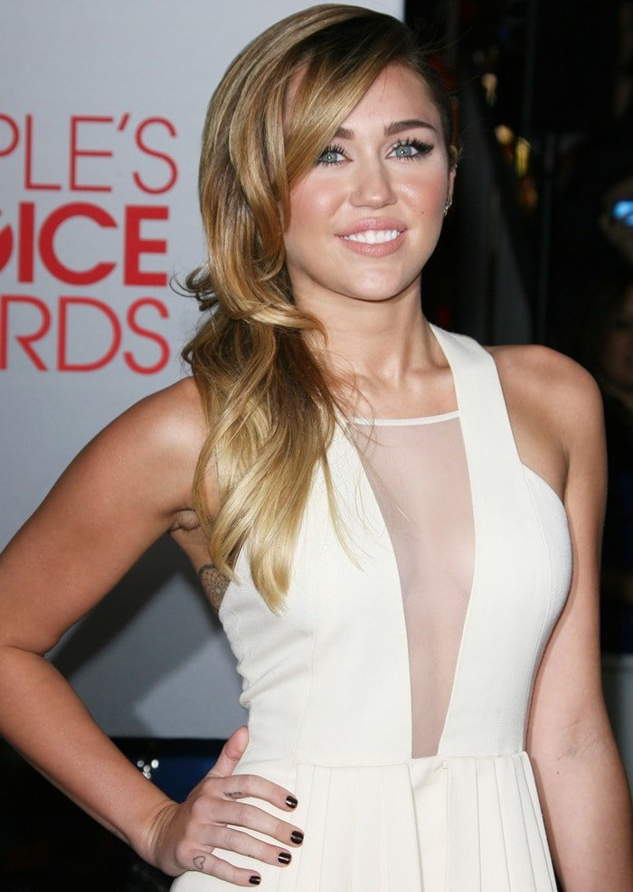 Miley Cyrus in a gorgeous David Koma sleeveless dress