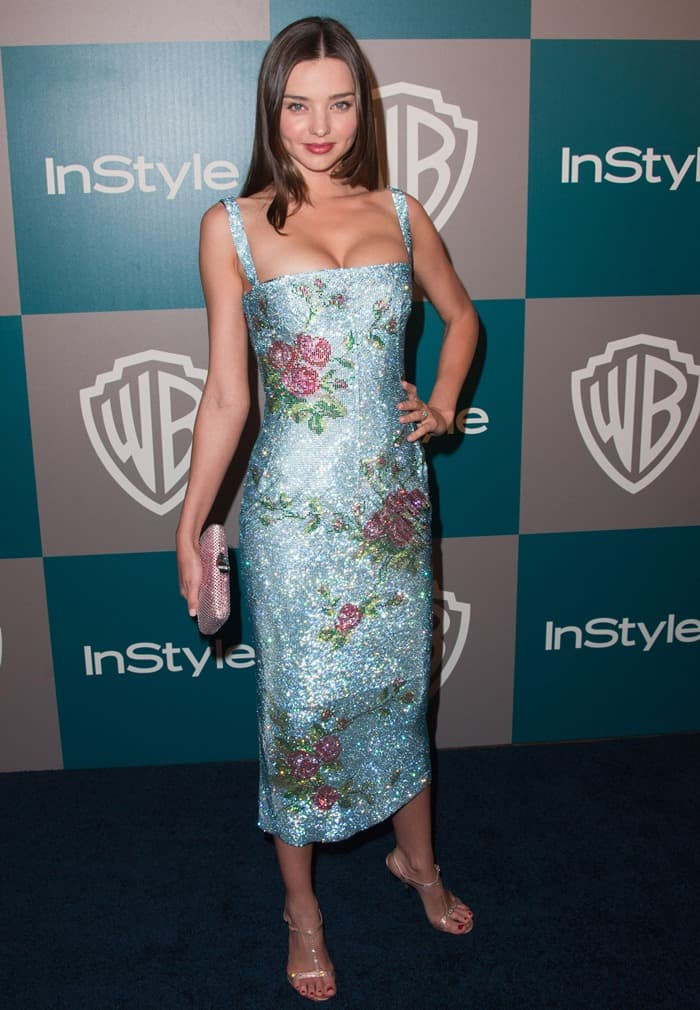 Miranda Kerr wearing a fitted floral print Dolce & Gabbana dress paired with these soft salmon colored embellished heels
