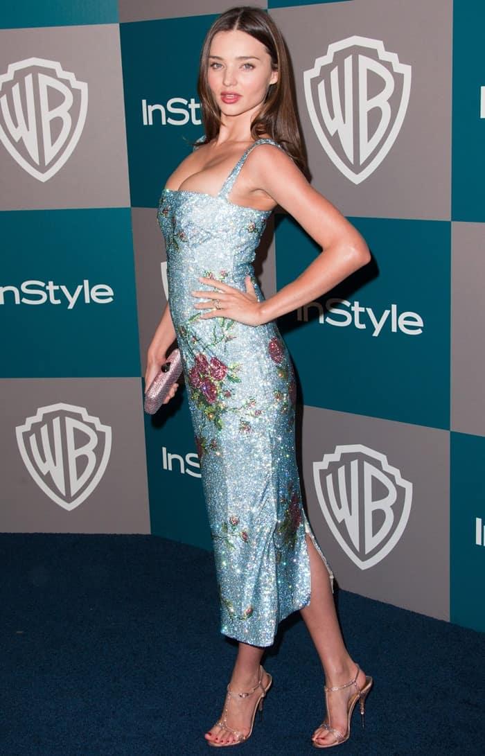 Miranda Kerr in a floral print Dolce & Gabbana dress and Giuseppe Zanotti crystal embellished sandals