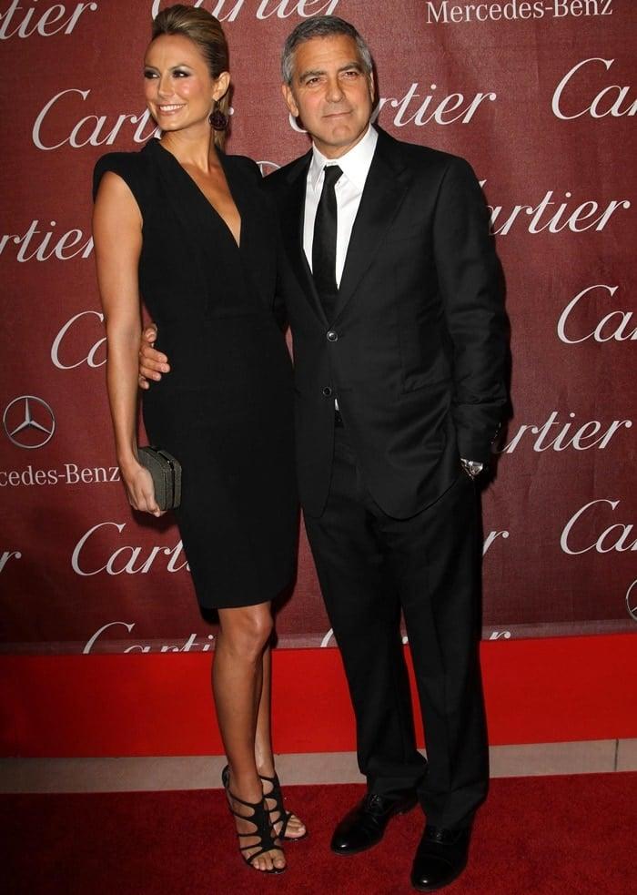 Stacy Keibler flaunted her sexy legs in a black deep V-front Alexander McQueen dress