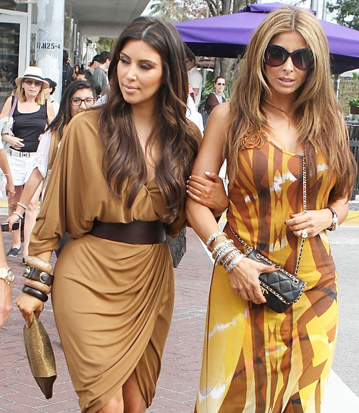Kim Kardashian sported a simple tan dress and toted a matching clutch