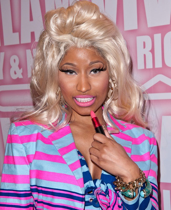Nicki Minaj was decked out in a striped pink and blue dress and blazer set from the Nanette Lepore Spring 2012 collection