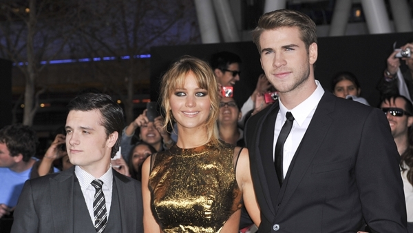 Josh Hutcherson, Jennifer Lawrence and Liam Hemsworth at the World Premiere of 'The Hunger Games' held at Nokia Theatre in Los Angeles, March 13, 2012