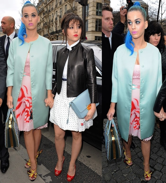 Katy Perry went for a mismatched look and paired a mint green collarless coat with a pale pink dress