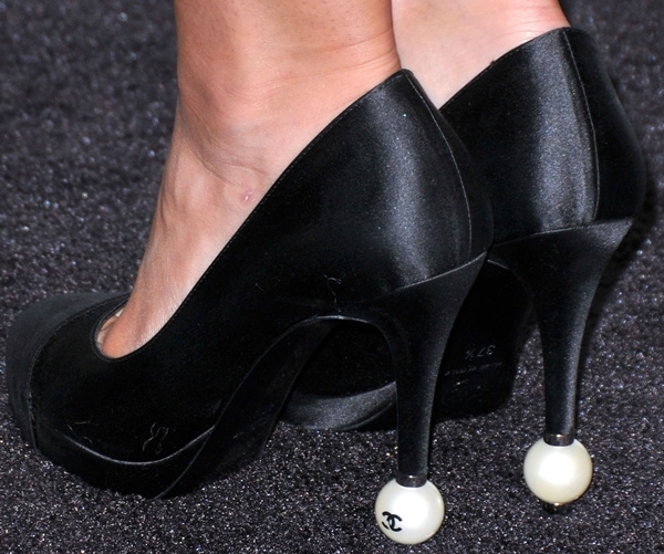 Lily Collins shows off her feet in black Chanel pearl pumps