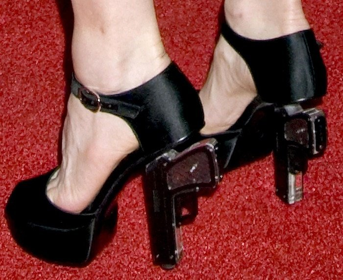 Madonna shows off her feet in gun high heels