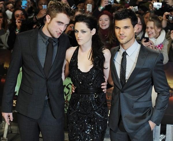 Robert Pattinson, Kristen Stewart and Taylor Lautner attend the UK premiere of The Twilight Saga: Breaking Dawn Part 1 at Westfield Stratford City on November 16, 2011 in London, England