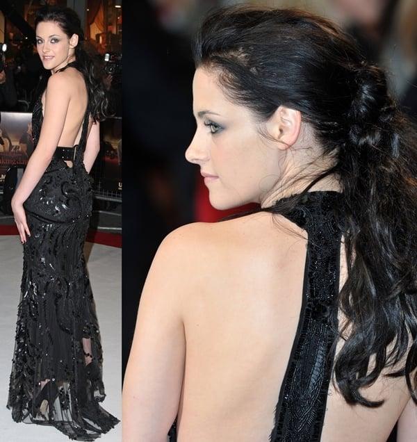 Kristen Stewart wearing a black sequined floor-length Roberto Cavalli dress