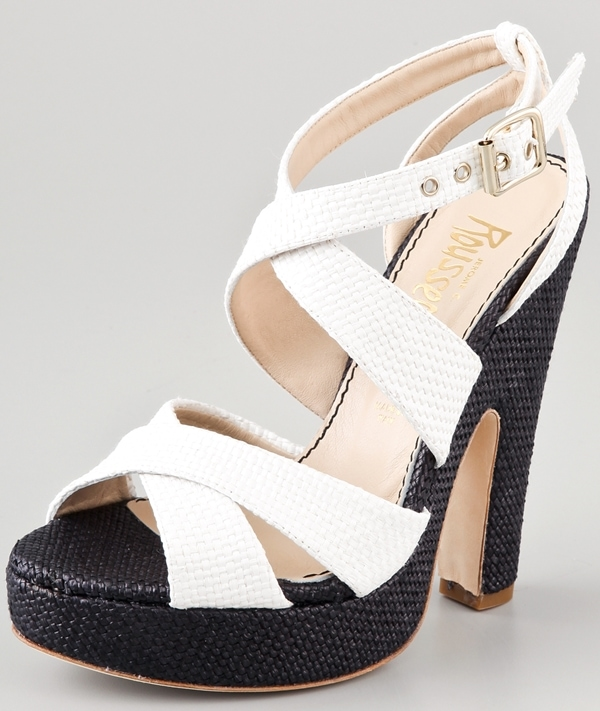These raffia heels feature crisscross straps at the vamp and a buckle closure at the ankle.