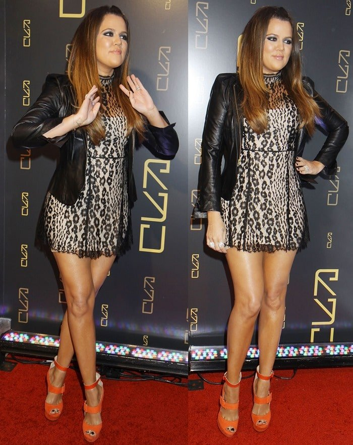 Khloe Kardashian showed off her legs in a short leopard print mini dress from Lover Labyrinth