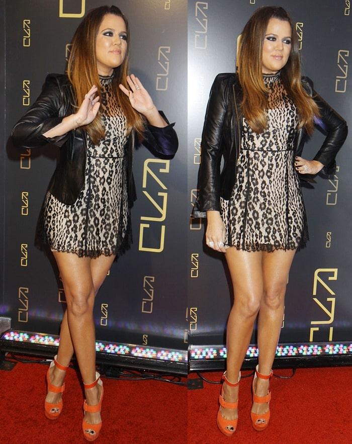 Khloe Kardashian showed off her legs in a short leopard print mini dress from Lover Labyrinth