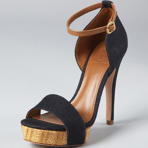 These canvas platform sandals feature woven detailing at the platform and a buckled strap at the ankle