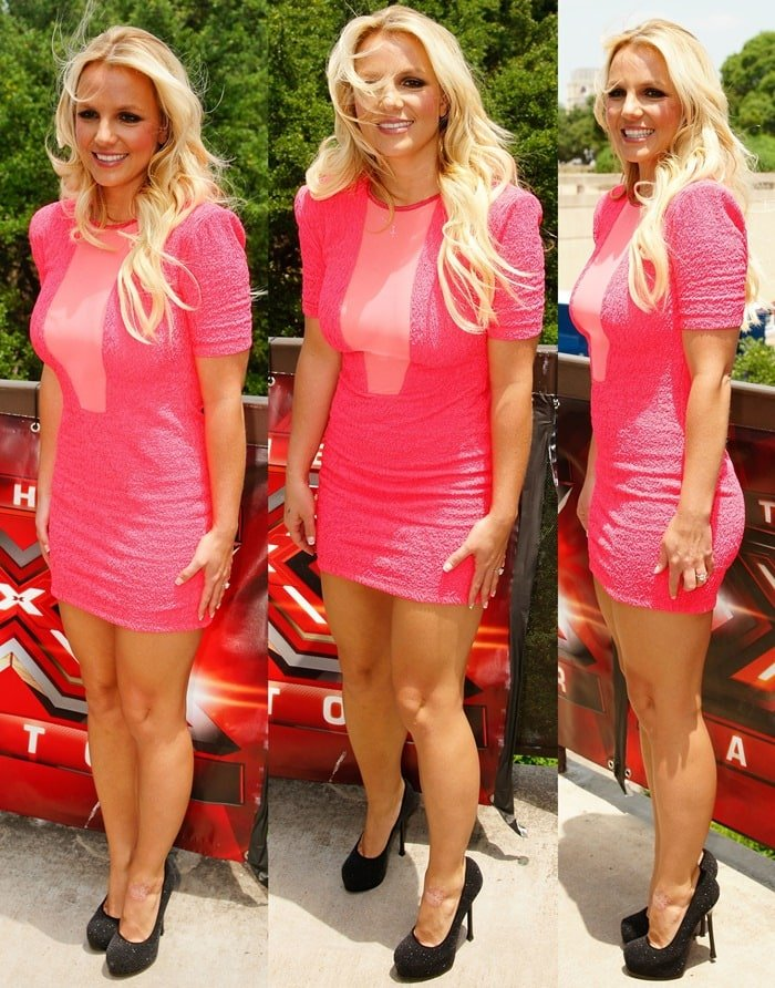 Britney Spears wearing a pink short sleeve textured mini scuba by Brian Lichtenberg featuring a plunging mesh inset at the crew-neckline