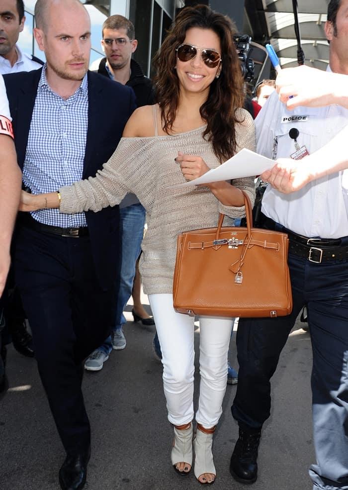 Eva Longoria in a white tee and skinny jeans