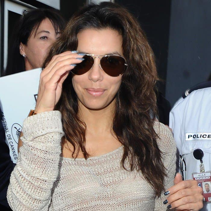 Eva Longoria arrives at Nice Airport for the Cannes Film Festival on May 16, 2012
