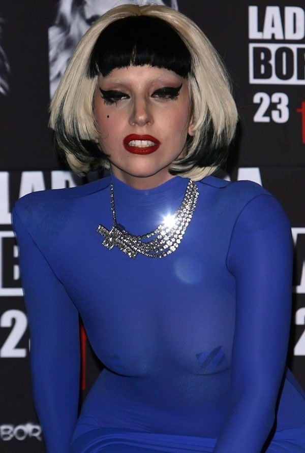 Lady Gaga wears a sheer blue dress at a pre-concert press conference in Mexico City
