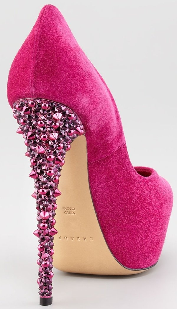 This fun studded heel pump features an allover luxurious hot pink suede