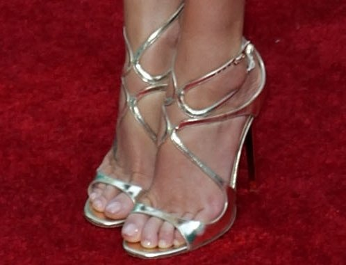 Charlize Theron shows off her feet in strappy metallic Jimmy Choo sandals