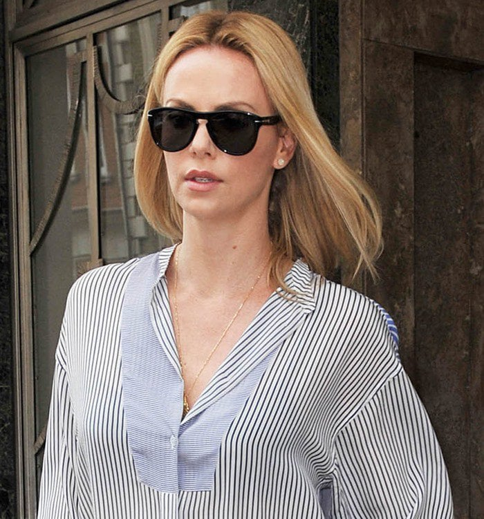Charlize Theron wears her hair down as she leaves Claridges hotel in London