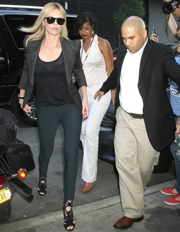 Charlize Theron rockingJimmy Choo's 'Imogen' caged sandals with delicate cutouts