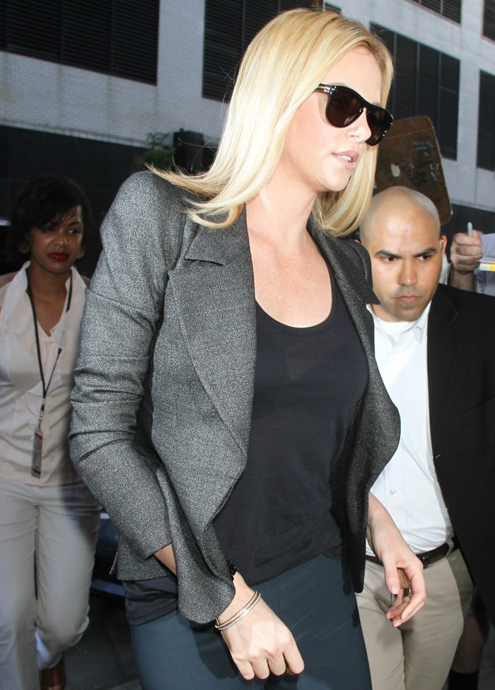 Charlize Theron arrives for a taping of the 'Colbert Report' to talk about her new movie 'Snow White and the Huntsman'