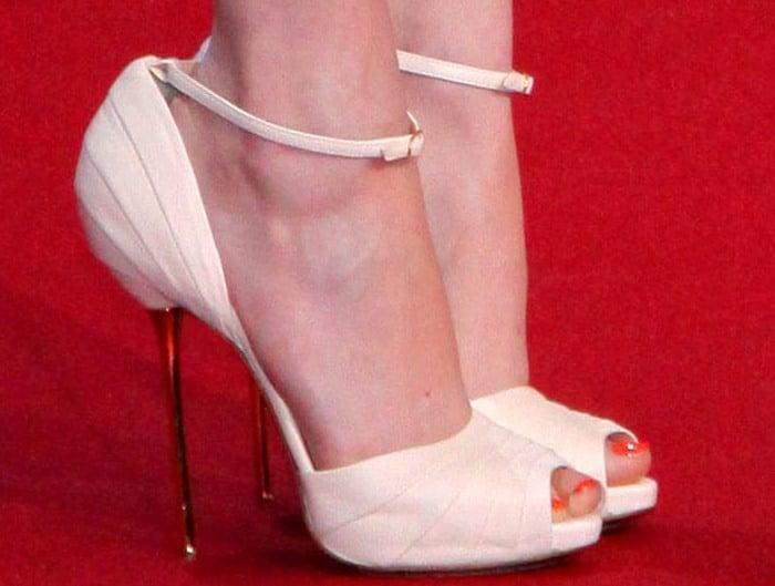 Emma Stone's feet in peep-toe Christian Louboutin pumps