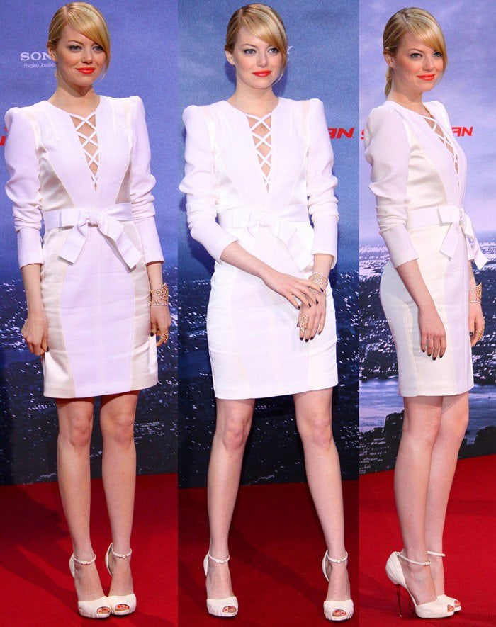 Emma Stone shows off her legs in a white lace-up dress from Andrew Gn