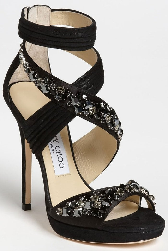 Shimmery suede swathes a dazzling, crystal-drenched sandal perched atop a slim heel