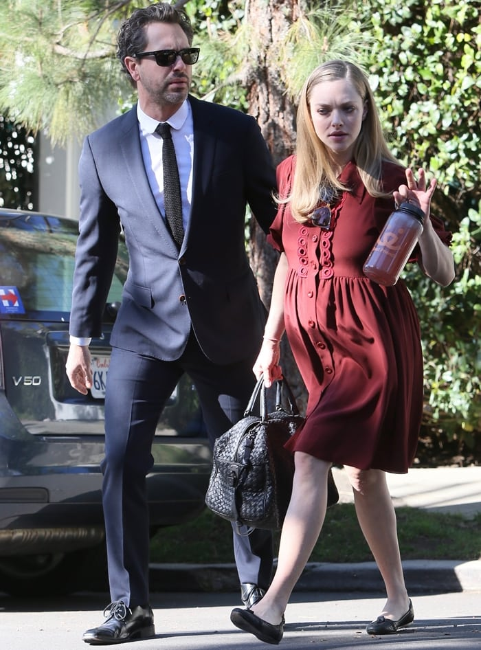 Pregnant Amanda Seyfried shows off her baby bump while out with her fiancé Thomas Sadoski